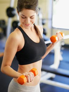 Woman doing arm curls with dumbbells